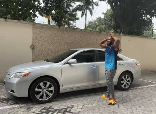 Musician, Flavour gifts his childhood frien a car (PHOTOS)